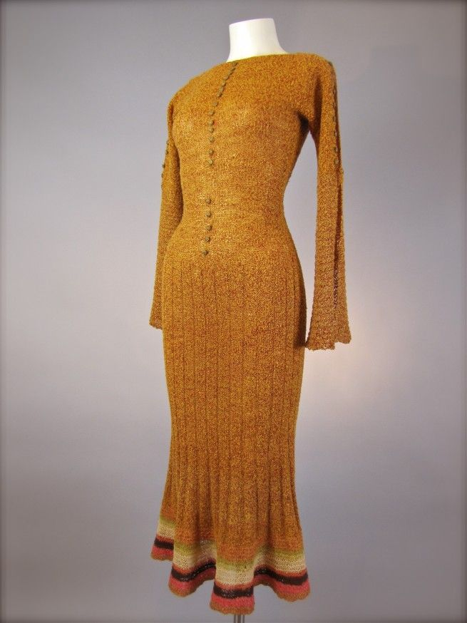 great dress! great color!  1930's Copper Orange Couture Vintage Knit Dress. The boxy, short dresses of the 1920s now give way to longer hemlines and garments that cling to the body.
