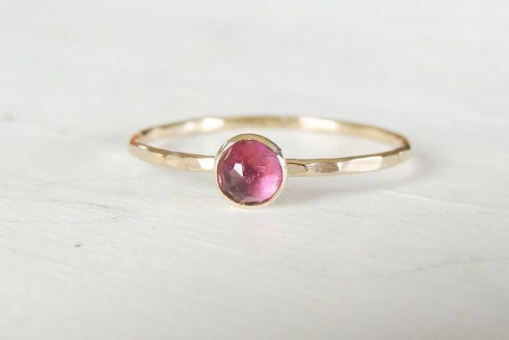 purple gem and gold ring