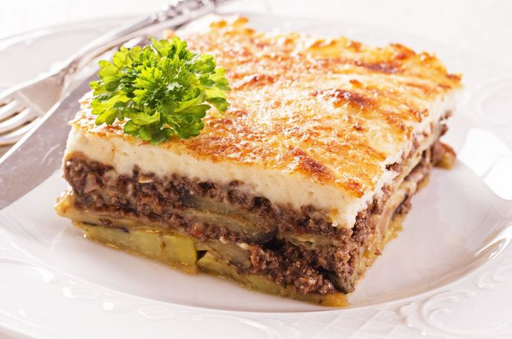 Imagine layers of juicy minced beef, sweet eggplants, and creamy béchamel sauce baked to perfection! This is #greek #Moussaka! Re-discover this truly authentic dish here... Need this in my life! <3