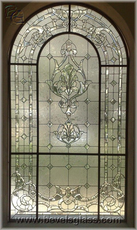 arched leaded glass window - gorgeous over a tub