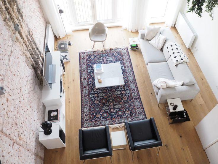 Loft rotterdam brickwall arne jacobsen 3300 chair frits hansen vintage modern interior persisch tapijt