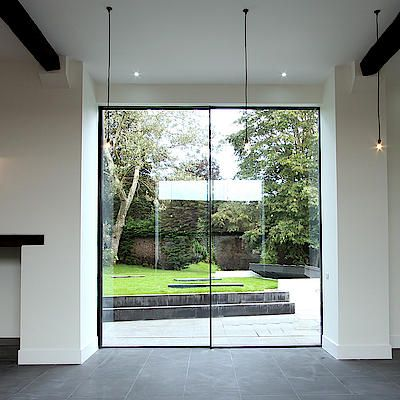 KELLER minimal windows are frameless sliding windows which create open living concepts that let in maximum light