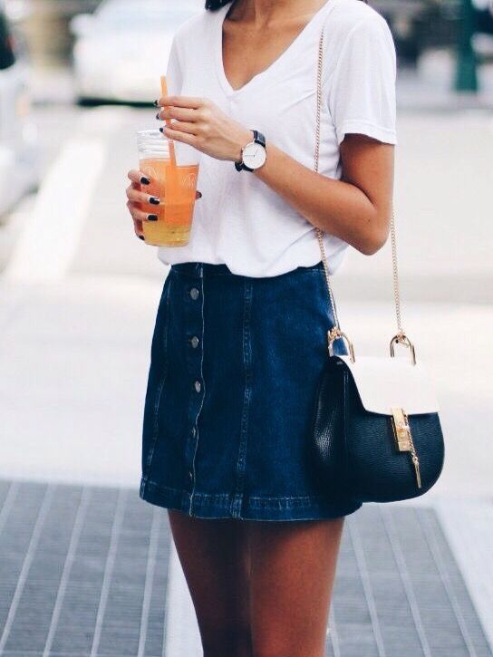 Street style | Plain white t-shirt tucked in denim buttoned mini skirt and a…