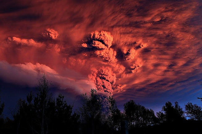 A plume of ash, estimated six miles (10km) high and three mile wide is seen after a volcano erupted in the Puyehue-Cordon Caulle volcanic chain, about 575 miles (920 km) south of the capital    Santiago, Chile  June 4, 2011    Image Credit & Copyright: Ivan Alvarado