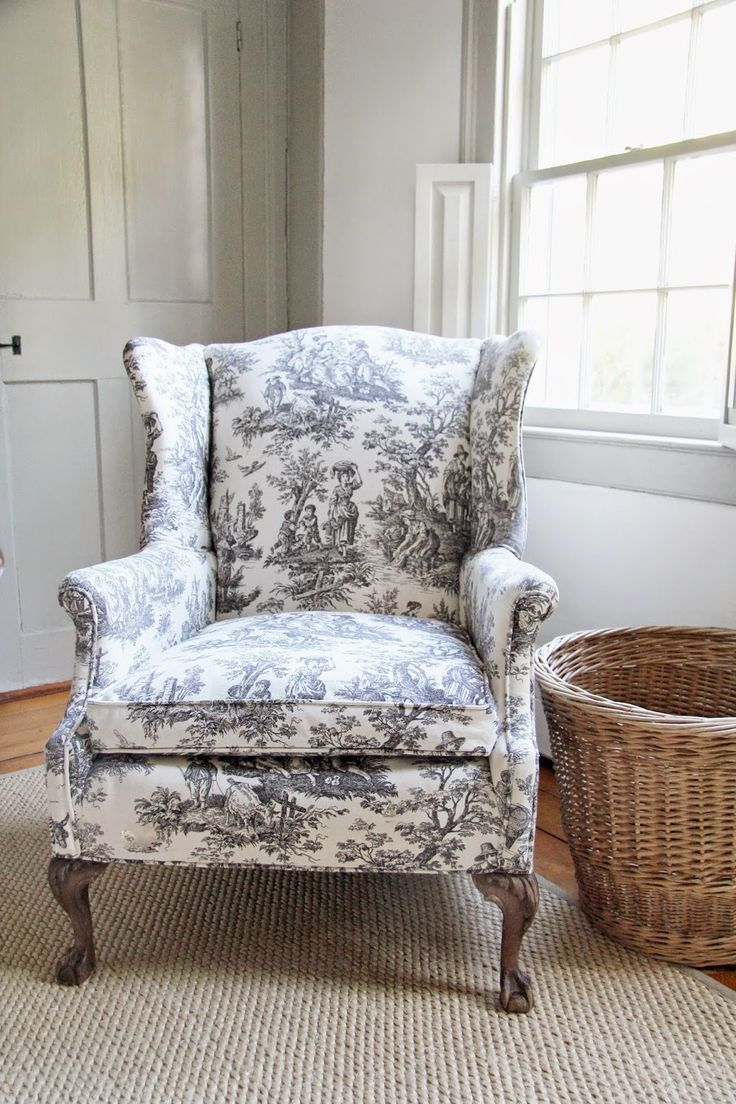 toile wing back chair with rattan basket