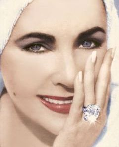 Elizabeth Taylor, BLING engagement ring to Richard Burton. Love the picture!
