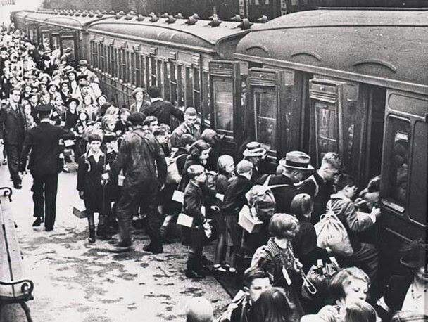 Children being evacuated from Liverpool during WWII board a train at the Lime…