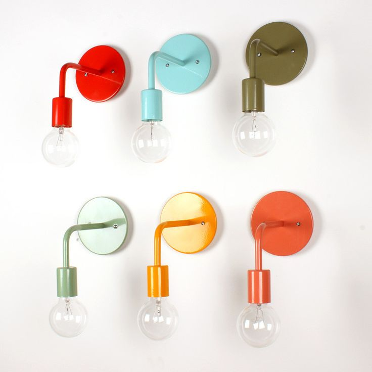 Colored wall sconce, rather pricey but could be done with those ugly box lights in most bathrooms (just leave the bulbs exposed)