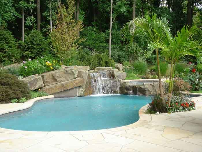 Backyard swimming pool designs tropical backyard swimming pool and spa waterfall design ideas - Swimming pools with waterfalls ...