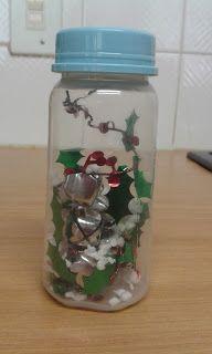 Sensory bottle - Christmas theme -  Bottle filled with mistletoe tinsel, shaker chimes and flaked flaked styrofoam (for snow effect)