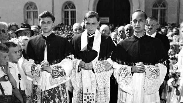 PHOTO: The brothers Joseph, left, and Georg Ratzinger, middle, with their friend Rupert Berger at the welcome ceremony in their home parish in Traunstein after their priestly ordination. - ABC News
