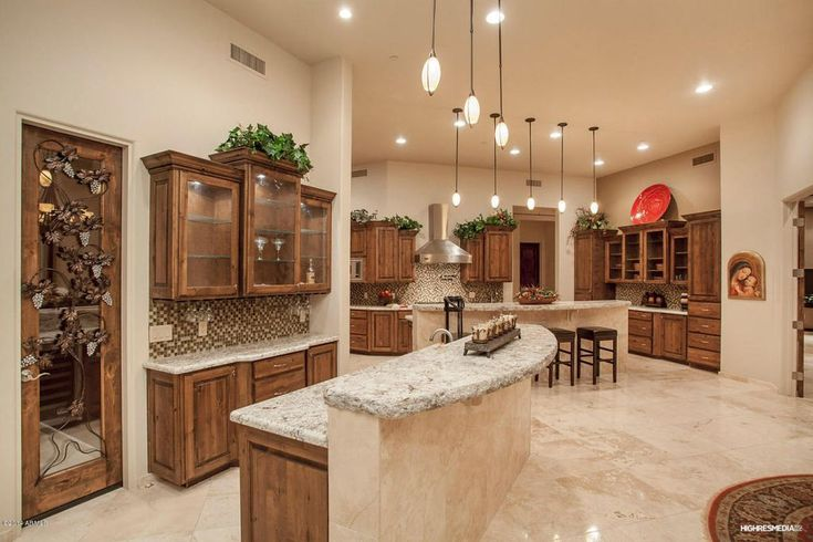 Traditional Kitchen with Complex granite counters, Colisseum 12 in. x 12 in. Honed Travertine Floor and Wall Tile, U-shaped