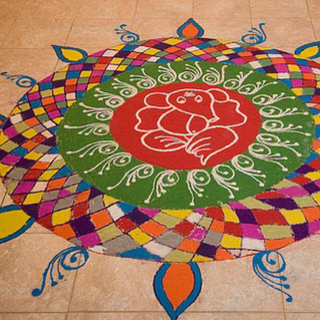 Rangoli. (Indian design made entirely of coloured rice and powder, during religious Hindu Festivals)
