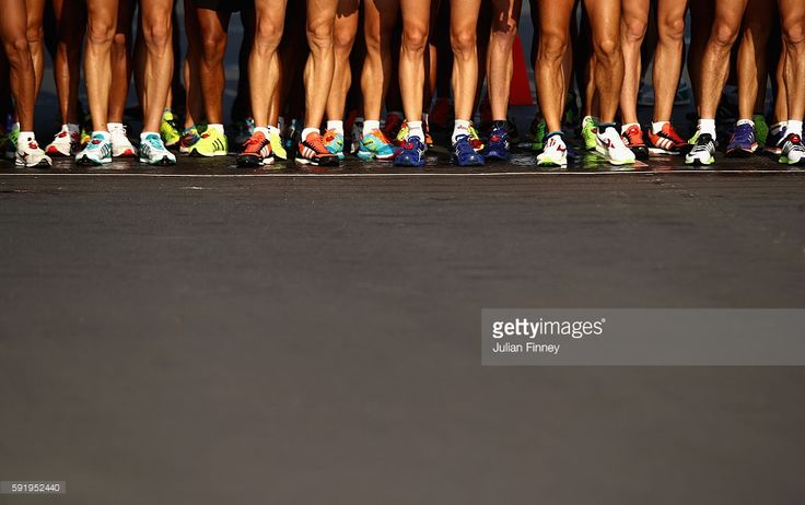 Competitors wait at the start line for the Men's 50km Race Walk on Day 14 of the…