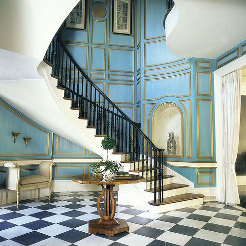 HGTV dream house aqua paneled stair hall.