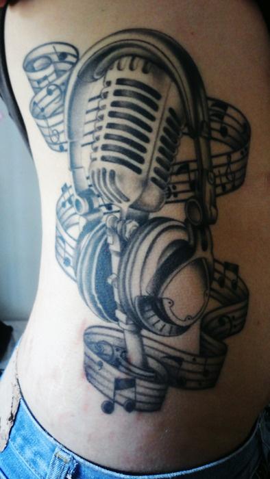 Tattoo: beautiful microphone and headphones side piece.