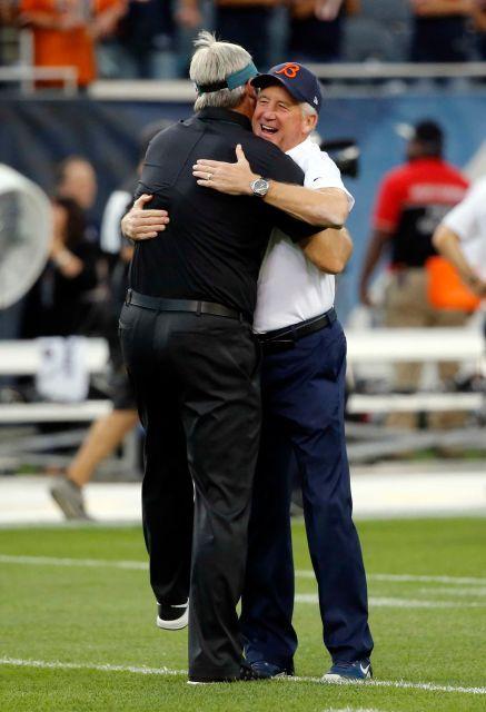 Chicago Bears head coach John Fox, right, hugs Philadelphia Eagles head coach Doug Pederson before an NFL football game, Monday, Sept. 19, 2016, in Chicago.
