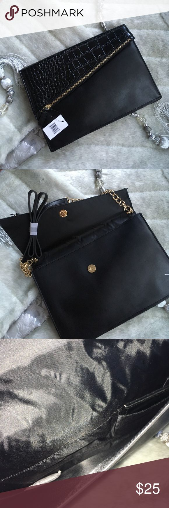Black Vegan leather w/Faux alligator clutch/bag NWT vegan leather in black with Faux alligator detail clutch or crossbody purse - very versatile in use - can be use in all 3 ways - the top zipper part opens up for additional storage Bags Clutches & Wristlets