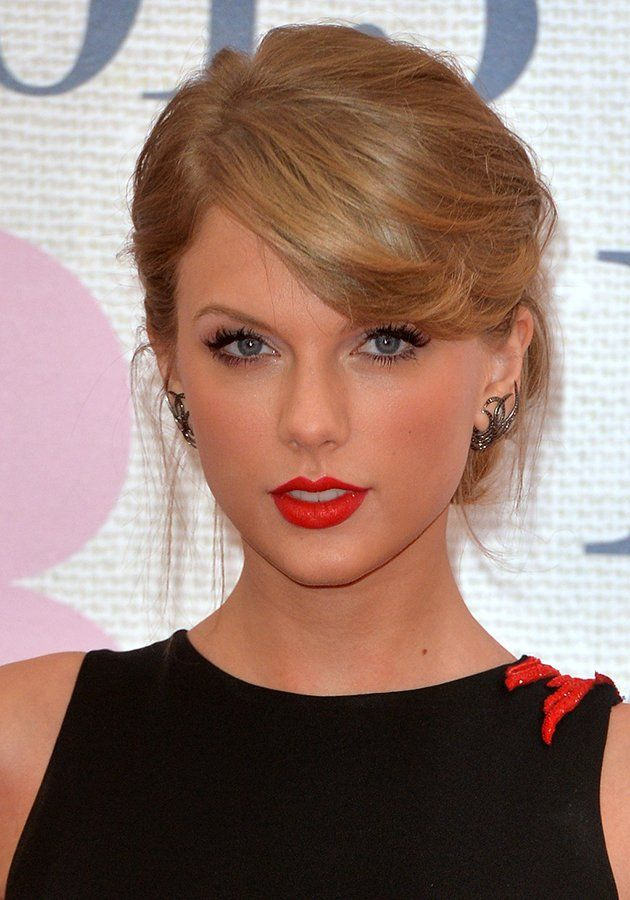 Taylor Swift rocked a tomato-red lipstick on the BRITs red carpet [Getty]