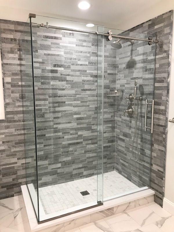 Barndoor Style Frameless Shower Door W Stainless Steel Hardware Barndoor Centurybathworks Showerdoor Shower Doors Glass Shower Glass Shower Enclosures