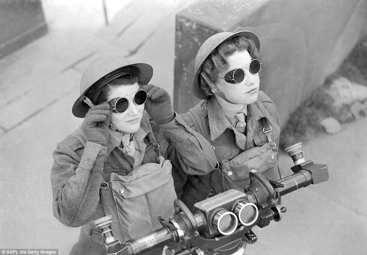 WWII Dangerous work: Auxiliary Territorial Service spotters scan the skies for any sign of hostile aircraft at a London anti-aircraft battery, equipped with a range finder