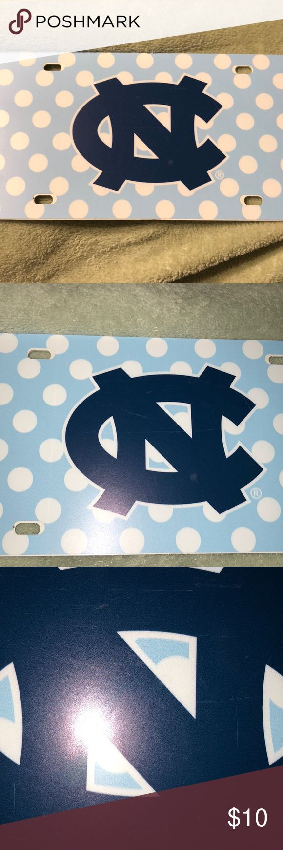 License plate UNC Chapel Hill license plate!  Perfect for those die hard Tar Heel fans 👣 Never been used, but couple scratches on logo (pictured in last photo) Other