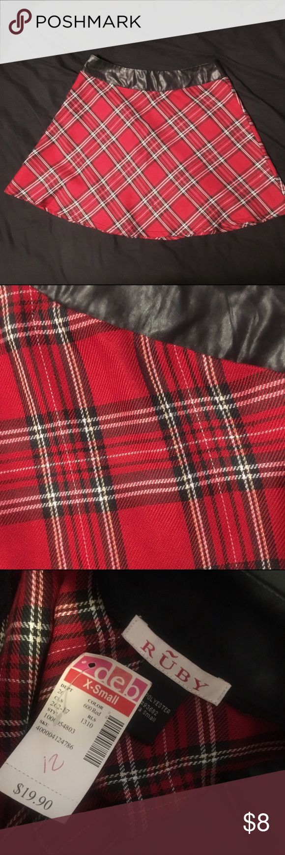 Red Plaid Skater Skirt w/ Black Pleather Band This flirty schoolgirl style skirt has a faux leather waist band for a rebellious flair. Ruby Skirts Mini