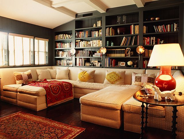 Kind of what I'm thinking for downstairs... library behind w/ a big comfy couch! Maybe some gray walls