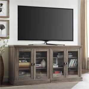 Altra Furniture Bennett Glass Door TV Stand - Keep your entertainment space, office, or bedroom organized with the Altra Furniture Bennett Glass Door TV Stand . This versatile TV stand can...