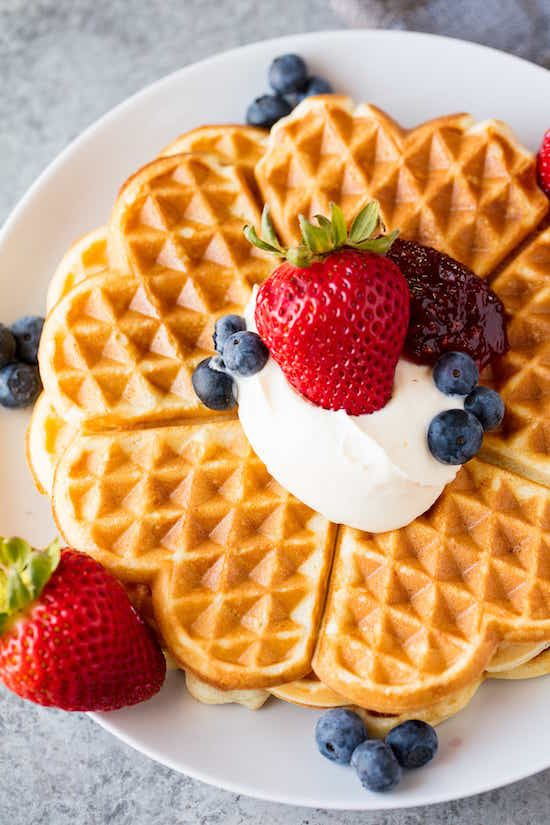 Easy Norwegian Waffles are sweet, crisp, and perfectly delicious. These heart shaped waffles are an amazing breakfast or dessert.