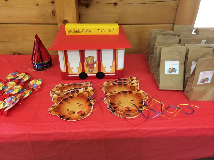 Trolley, favor bags, and tiger masks for Daniel Tiger party!  Daniel Tiger's Neighborhood