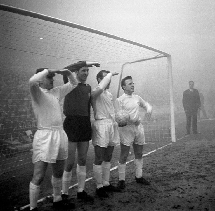 Tottenham Hotspur players Dave MacKay, goalkeeper Bill Brown, Jimmy Greaves and Terry Dyson (l to r) peer out into the fog in search of Manchester United players.