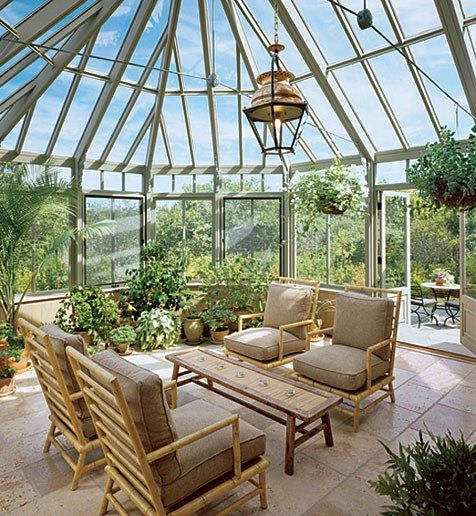 A lantern purchased in paris hangs in the cedar and glass conservatory at this martha 39 s vineyard for Sunroom garden room