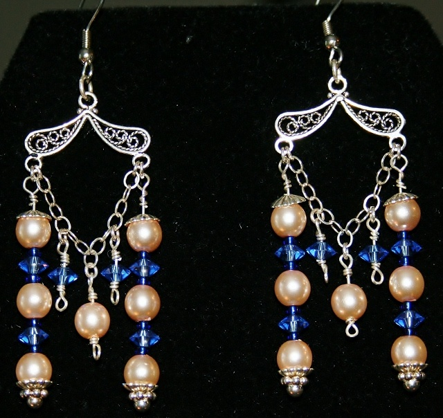Blue & Pink Dangle earrings feature Swarovsky crystals and pearls with Sterling Silver components.