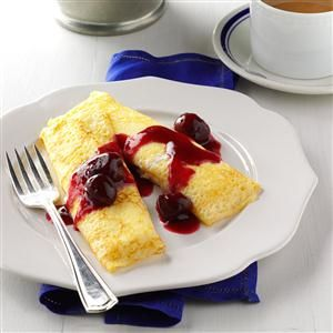 Cherry Cheese Blintzes Recipe -These elegant blintzes can be served as an attractive dessert or a brunch entree. The bright cherry sauce gives them a delightful flavor. I sometimes substitute other fruits, such as raspberries, blueberries or peaches. -Jessica Vantrease, Anderson, Alaska