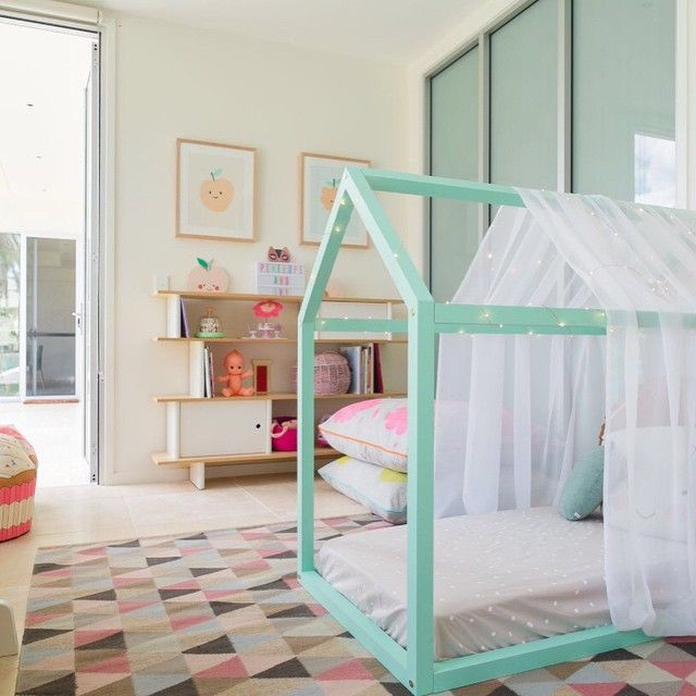 Love the mint color for the floor bed also. Also love the painted floor-to-ceiling sliding closet door panels.