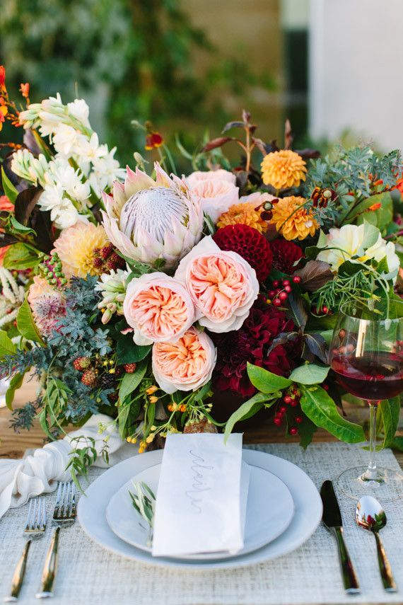 Gorgeous end-of-summer centerpiece with garden roses, dahlias, and a king protea