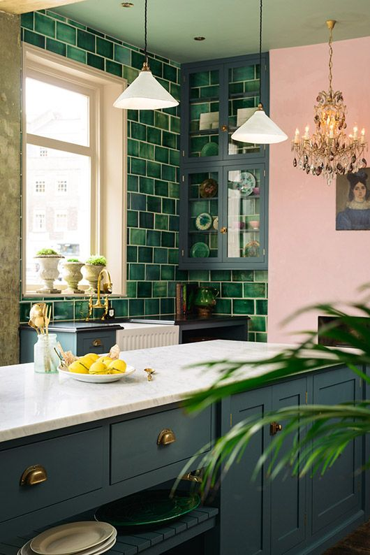 Hello beautiful bold colorful kitchen of magic. Green tile against marble countertops, millenial pink walls and those midnight navy blue cabinets. Wow.