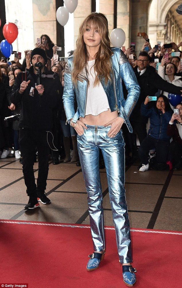 Power dressing: The 21-year-old model looked incredible in a daring metallic suit from the collection, exuding effortless glamour in the tomboy inspired attire