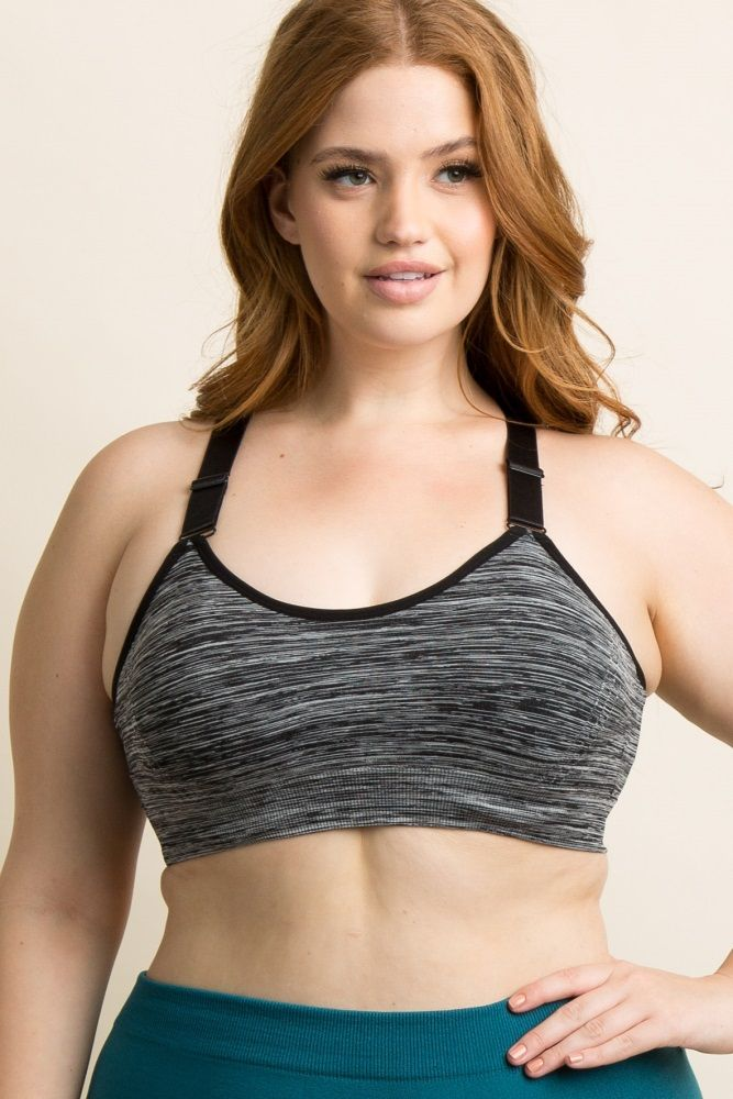A heathered plus size sports bra featuring a racerback style and adjustable straps with an O-ring back accent. Also features a rounded neckline with removable padded cups.