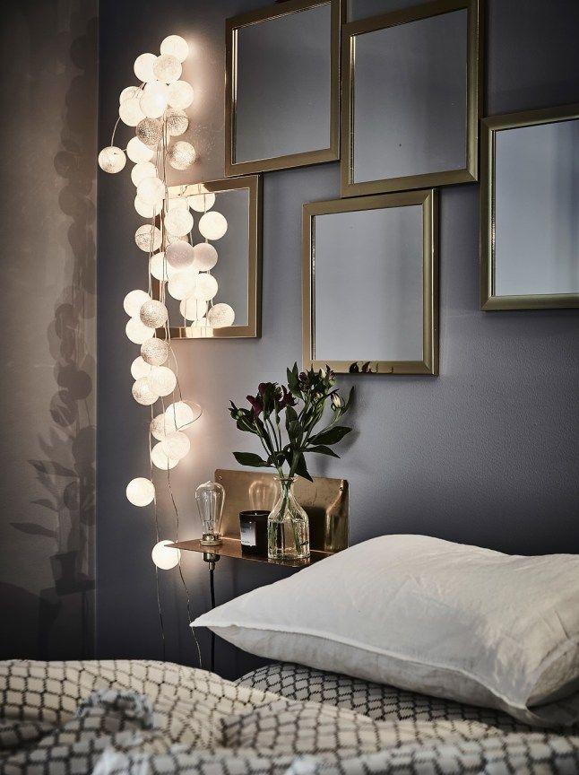 Miroir sur la cloison entre le lit et le dressing pour apporter lumière et sensation d'espace plus grand