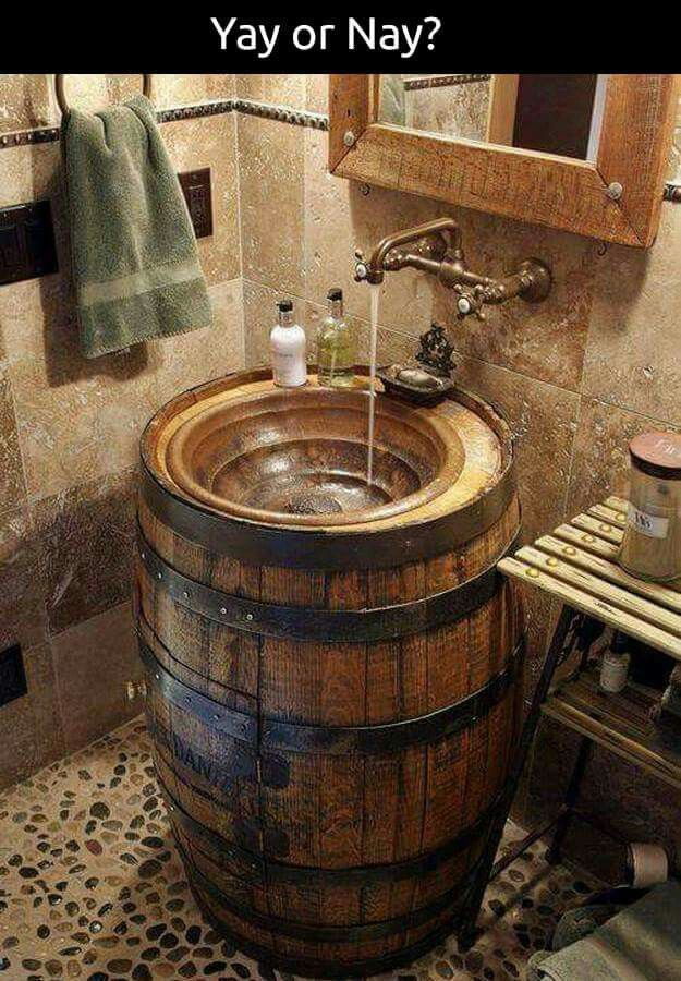 This would be perfect for a horse themed powder room. I've seen copper bowls with horse ir barbed wire designs that would be perfect inset into a repurposed barrel.
