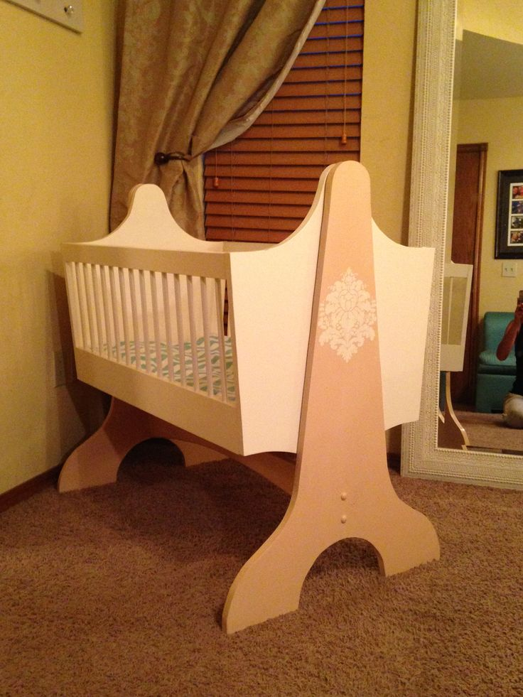 Hand-painted wooden baby cradle