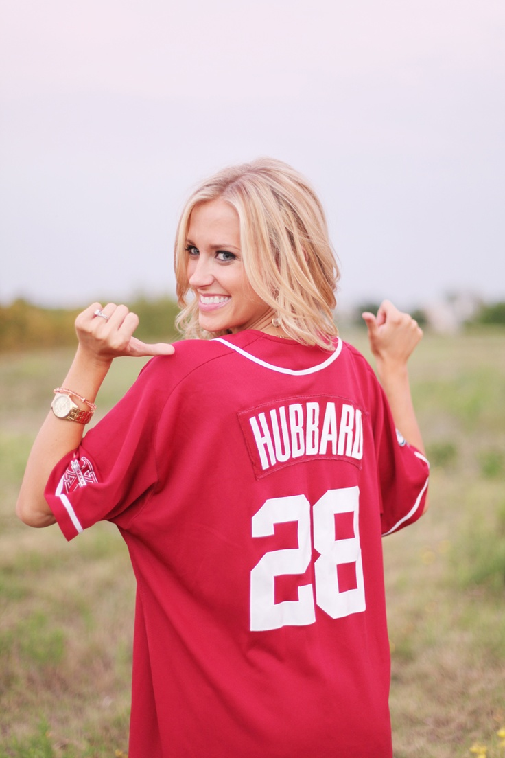 Cute engagement photo idea!  I have a football jersey that says Howard on it!! score!