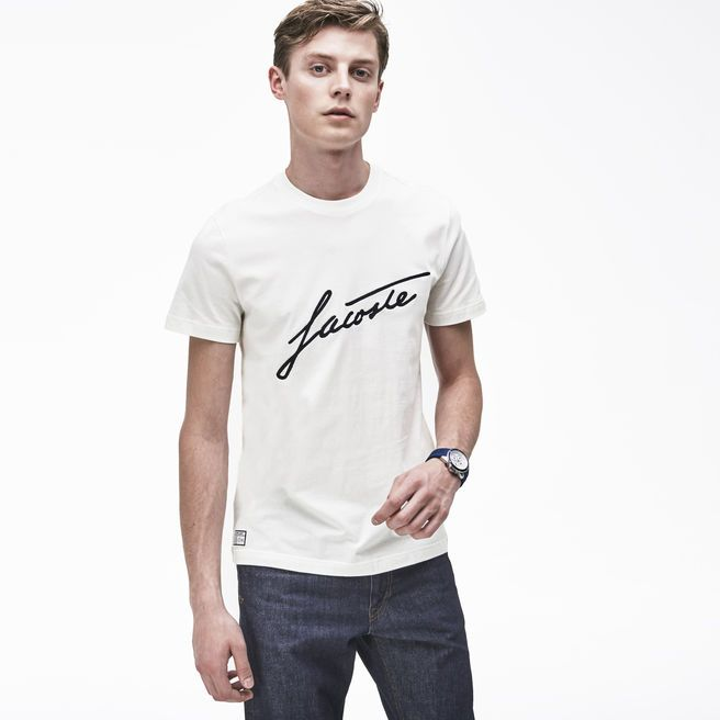 """White inscripted """"Lacoste"""" T-shirt + jeans = perfect casual outfit."""