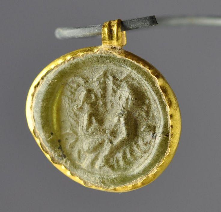 Roman gold pendant with glass token with roman sex scene, 2nd century A.D. Roman jewelry, Roman gold pendant with inserted glass roundel with sex scene, 1.8 cm diameter. Private collection