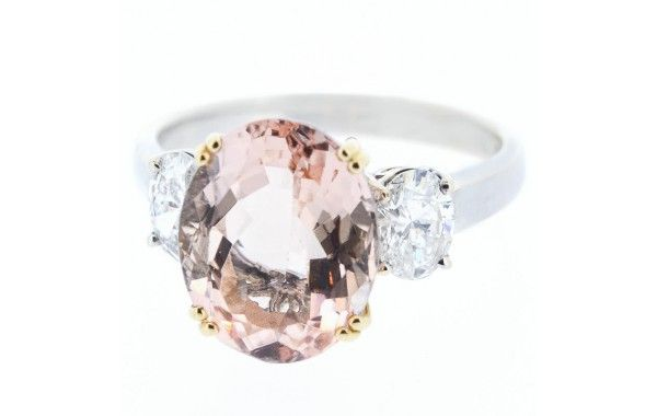 18ct white gold diamond ring, featuring a centre oval morganite, set with an oval diamond either side.