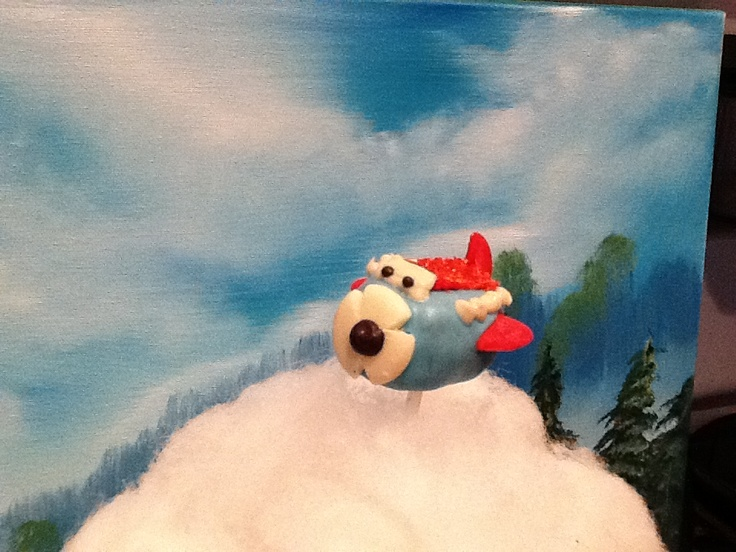 Airplane cake Pop and I also did the oil painting in backround