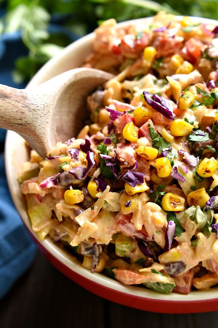 Taco Salad meets coleslaw in this deliciously creamy Mexican Coleslaw! Packed with flavor and perfect for summer cookouts! Sub plain Greek yogurt for mayo for a healthy alternative.