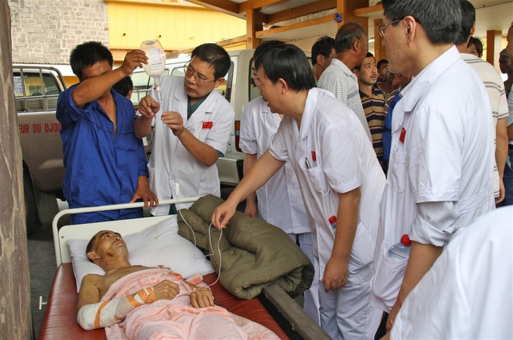 A Chinese worker injured in a 4 March 2012 munitions explosion in Brazzaville awaits evacuation
